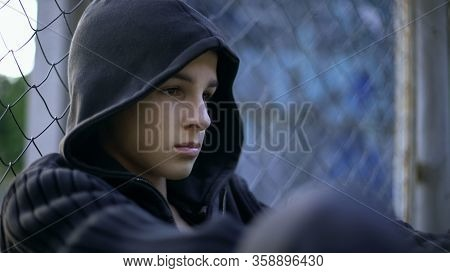 Upset Teen Suffering School Bullying, Dysfunctional Family, Depression Concept