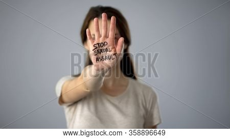 Stop Sexual Assault Sign On Womans Hand, Discrimination Prevention, Assault