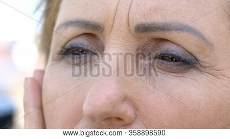 Senior Woman Touching Her Wrinkled Face, Skin Aging Process, Desire To Be Young