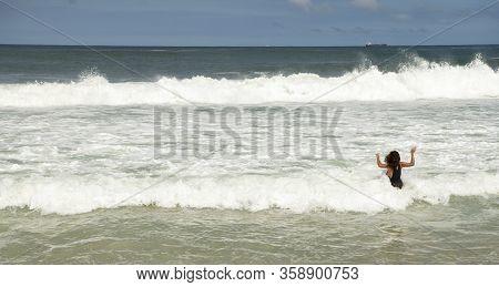 Rio De Janeiro, Brasil-  February 28, 2020: Citizens Swim On The Beach Of Copacabana