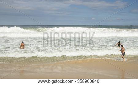 Rio De Janeiro, Brasil-  February 28, 2020: Citizens On The Beach Of Copacabana