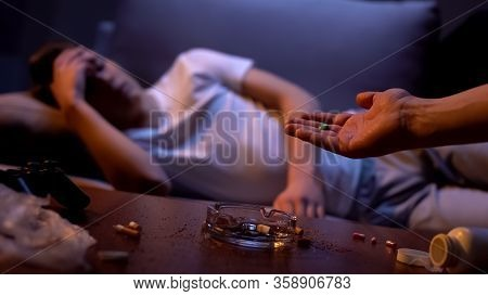 Hand Offering Drug Addicted Young Male Tablet, Detrimental Habit, Club Drugs
