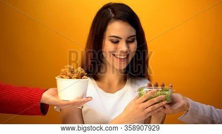 Girl Choosing Salad Instead Of Fried Meat, Healthy Food For Weightloss, Diet