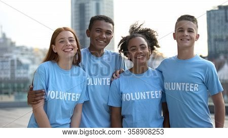 Happy Young People Volunteer T-shirts Posing Camera, Social Teamwork, Help