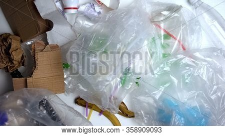 Litter Lying On White Background, Ecological Catastrophe, Recycling Problem