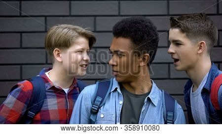 Evil Students Teasing Black Boy Face-to-face, Telling Insults, Racial Bullying