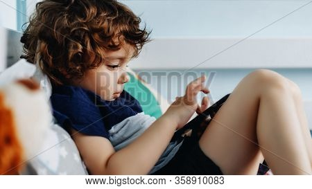 Wow, I Like That Phone. Baby With Smartphone. Boy Sitting In Bed And Playing With Mobile Phone. Call