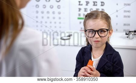 Happy Child In Glasses Eating Carrot On Recommendation Of Doctor, Beta-carotene