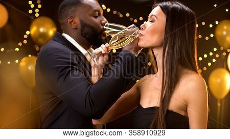 Happy Male And Female Drinking Champagne Brotherhood At Cocktail Party, Luxury