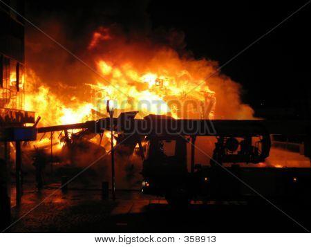 Firetruck Infront Of Burning House
