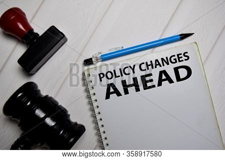 Policy Change Ahead Write On A Book Isolated On Office Desk.