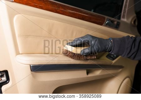 Cleaning The Car Door Trim With A Brush. Detaling Concept