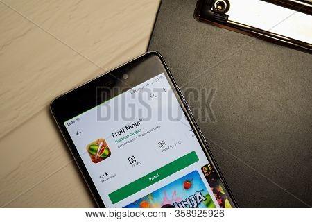 Bekasi, West Java, Indonesia. April 1, 2020 : Fruit Ninja Dev Application On Smartphone Screen. Frui