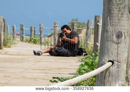Photographer Sit In Old Wood Runaway While Is Working