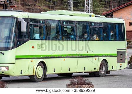 Ruzomberok, Slovakia - March 31, 2020: Passengers With Face Mask In Bus. Coronavirus Prevention