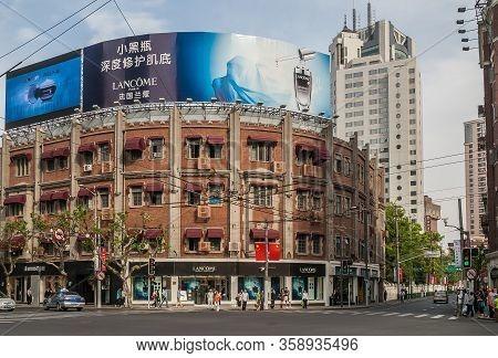 Shanghai, China - May 4, 2010: Busy Nanjing Road Upscale Shopping District. Red Brick Lancome Corner