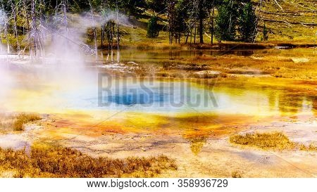 Bacterial Mats Surrounding The Turquoise Water Of The Steaming Hot Culvert Geyser In The Upper Geyse