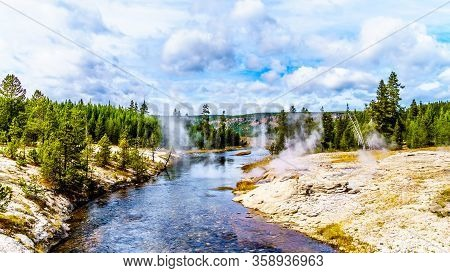 Hot Water From The Fan Geyser And Several Other Geysers And Hot Springs Flowing Into The Firehole Ri