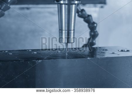 The Tapping Process On Cnc Milling Machine In The Light Blue Scene. The Hi-technology Manufacturing