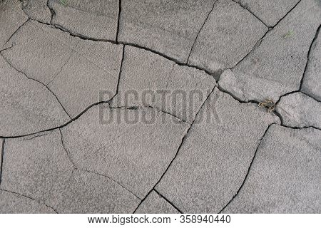 Grey Cracked Earth Ground From Drought Disaster Cause From Weather Change. The Global Warming And Gr