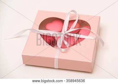French Cookies Macaroons In A Paper Box. Delivery Gift Box With Macarons. Valentines Day Celebration