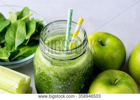 Glass Jar Of Healthy Green Smoothie Detox Drink Wirh Green Apple Celery And Raw Spinach Diet Beverag