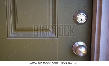 Front Door Of Home With Silver Door Knob And Front Door Deadbolt Lock