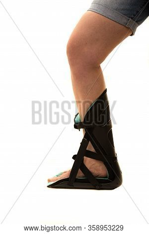 Profile Of Woman Leg In  Feet Orthosis  Isolated On White Background