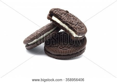 Oreo Biscuits Isolated On White Background. It Is A Sandwich Chocolate Cookies With A Sweet Cream Is