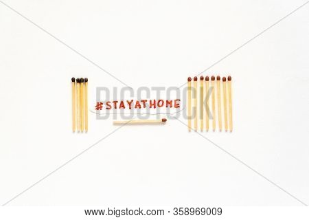 Stay At Home. Social Distancing Concept As Stayathome. Matchsticks Burn, One Piece Prevents The Fire