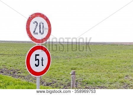 Old And New Road Signs 20 Km / H And A Maximum Of 5 Tons In The Countryside In Northern Germany.