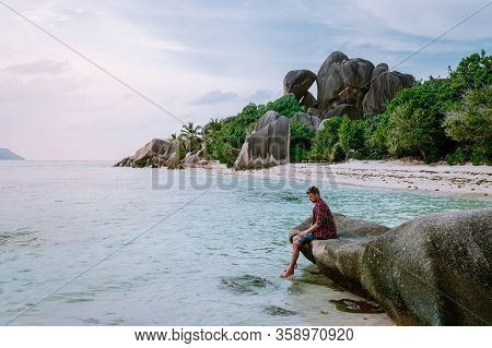La Digue Seychelles, Young Men On Vacation At The Tropical Island La Digue, Mid Age Guy Walking On T
