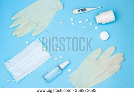 Coronavirus Protection And Treatment: Medical Mask, Hand Antiseptic, Gloves, Thermometer And Pills O