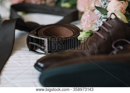 Men's Leather Shoes, Watches And Cufflinks On The Background Of A Brown Table. Clothing Accessories