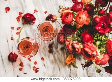 Rose Wine In Glasses And Red Spring Flowers, Top View