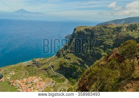 Views Of Mount Teide, A Village And A Cliff From The Glass Interior Of The Mirador De Abrante On The