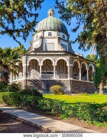 The Sea of Galilee. Israel. The Catholic Church of the Beatitudes of the Italian female Franciscan monastery on Mount Bliss. Blooming huge park around the monastery. concept of religious pilgrimage