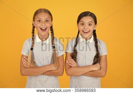 Cheerful Schoolgirls Yellow Background. Little Girls. Happy Childrens Day. Equal Protection Civil Ri