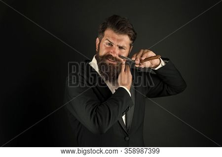 Manual Shaving. Bearded Man Shave Facial Hair Dark Background. Businessman Hold Shaving Tool. Profes