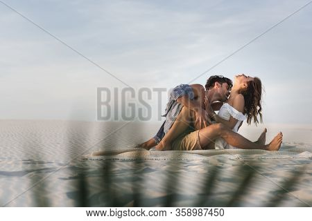 Selective Focus Of Passionate Young Couple Kissing On Blanket On Beach