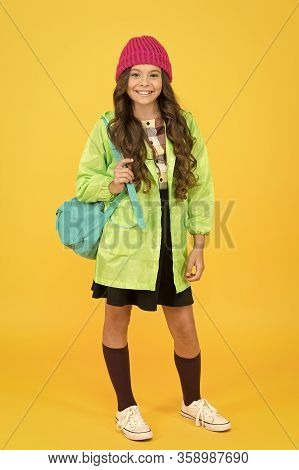 Study For Future. Happy Schoolgirl On Yellow Background. Small Child Back To School In Autumn Style.