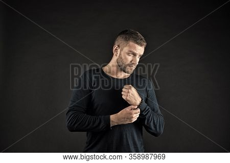 Macho Touch Bead Bracelet On Hand On Dark Background. Man With Beard On Unshaven Face In Blue Sweate