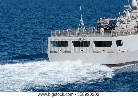 Stern Of Navy Surface Warship Sails With High Speed Creating White Bubble And Wave At The Stern Of T