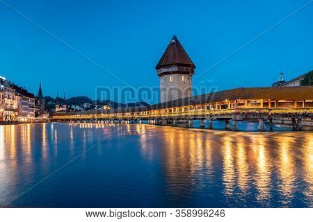 Famous Chapel Bridge, The Citys Symbol And One Of The Switzerlands Main Tourist Attractions, Switzer