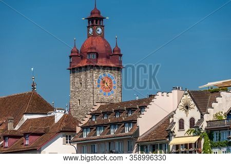 The Famous Red Clock Tower In Old City, Luzern, Switzerland.