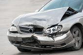 Damaged car on the road closeup in grey color poster