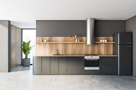Interior Of Stylish Kitchen With Grey And Wooden Walls, Tiled Floor, Comfortable Gray Countertops Wi