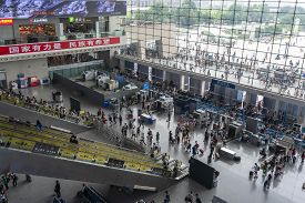 Chengdu, China - Aug 30, 2019: Passengers At The Security Checkpoint In A Busy Railway Station In Ch