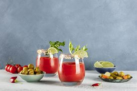 Bloody Mary Cocktail With Tomato Juice, Lime, And Celery, A Side View With A Place For Text