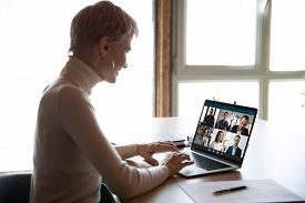 Female Employee Have Webcam Conference With Diverse Coworkers